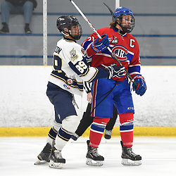 TORONTO, ON - JANUARY 5: Josiah Degazon #89 of the Toronto Patriots battles for control with Jason Pineo #21 of the Toronto Jr. Canadiens in the second period on January 5, 2019 at Westwood Arena in Toronto, Ontario, Canada.<br /> (Photo by Andy Corneau / OJHL Images)