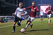 Chris Lines chases Louie Sibley during the The FA Cup match between Northampton Town and Derby County at the PTS Academy Stadium, Northampton, England on 24 January 2020.