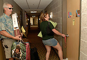 Ohio University sophomore Sarah Brocklesby unlocks the door to her Adams Hall room for the first time, while her father, Dallas Brocklesby, helps her carry her things Sunday afternoon.