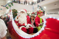 Santas visit to launch the Meadowhall grotto.Meet & greet winner Molly on the Parade with Santa..10 November 2011. Image © Paul David Drabble