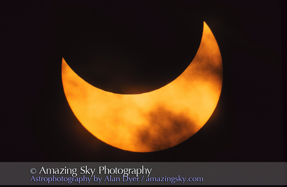 Partial solar eclipse<br /> Early 1970s from Winnipeg?<br /> Thru Celestron 8 and full-aperture solar filter and some cloud<br /> Kodachrome 25 film