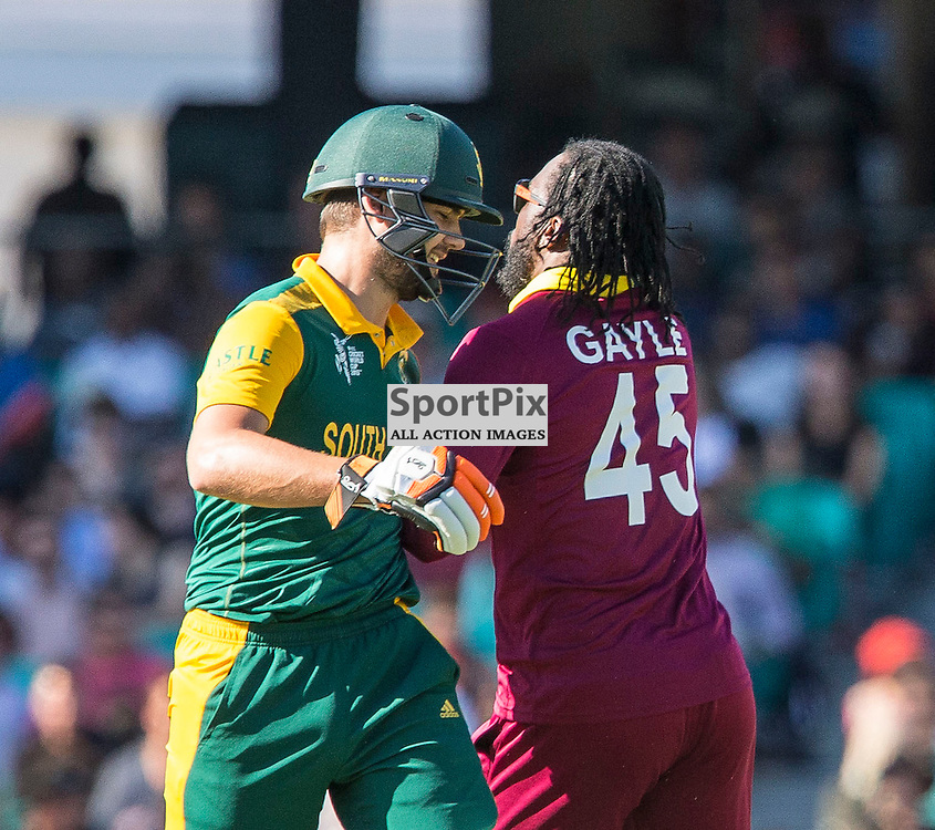 ICC Cricket World Cup 2015 Tournament Match, South Africa v West Indies, Sydney Cricket Ground; 27th February 2015<br /> West Indies Chris Gayle gives South Africa&rsquo;s Rilee Rossouw a friendly shove
