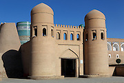 General view of main gate of Ichan-Kala, Ota Darvoza (Father Gate), Khiva, Uzbekistan, pictured on July 5, 2010, in the afternoon. The Kalta Minor is visible behind the gate. Khiva's old city, Ichan Kala, is surrounded by 2.2 kilometres of crenellated and bastioned city walls. Some sections may be 5th century, but the strongest sections were built 1686-88 by Arang Khan. The main gate today is the restored western Ota Darvoza (Father Gate). Khiva, ancient and remote, is the most intact Silk Road city. Ichan Kala, its old town, was the first site in Uzbekistan to become a World Heritage Site(1991). Picture by Manuel Cohen.