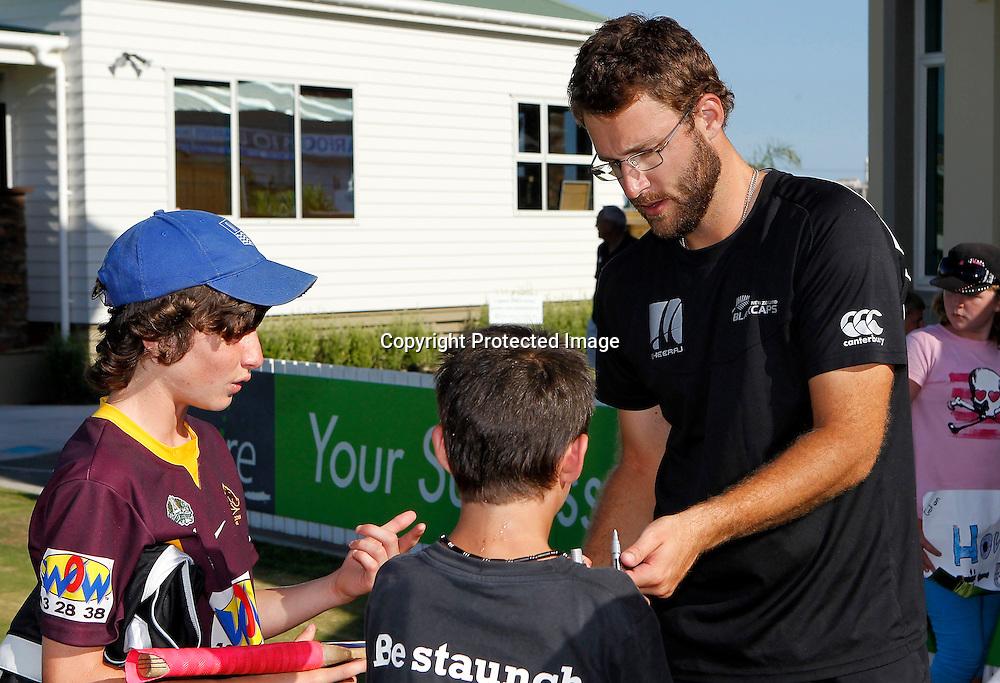 NZ XI's Daniel Vettori signs autographs. International Cricket, New Zealand XI v Pakistan, Cobham Oval Whangarei, Sunday 2nd January 2011. Photo: Shane Wenzlick / www.photosport.co.nz