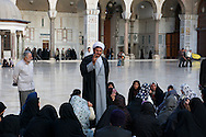 Mullah preaching to a group of women at Umayyad Mosque, Damascus, Syria.