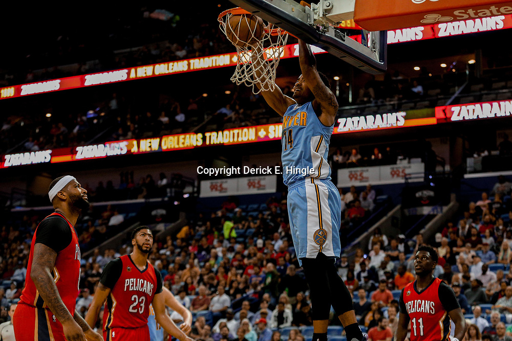 Apr 4, 2017; New Orleans, LA, USA; Denver Nuggets guard Gary Harris (14) dunks against the New Orleans Pelicans during the second quarter of a game at the Smoothie King Center. Mandatory Credit: Derick E. Hingle-USA TODAY Sports