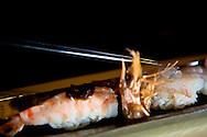 Here sushi is garnished with ice by Chef Noriaki Yasutake.