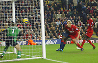 14/12/2004 - FA Barclays Premiership - Liverpool v Portsmouth - Anfield, Liverpool<br />Portmouth's Lomano Lua Lua scores the equalizing goal past Liverpool goalkeeper Jerzy Dudek and defender Sami Hyypia in the last minute of the game.<br />Photo:Jed Leicester/Back Page Images