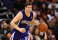 Nov 20, 2013; Phoenix, AZ, USA; Sacramento Kings guard Jimmer Fredette (7) dribbles the ball up the court in the second half of the game against the Phoenix Suns at US Airways Center. The Kings defeated the Suns 113-106. Mandatory Credit: Jennifer Stewart-USA TODAY Sports