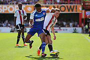 Brentford defender Callum Elder (3) tackling Ipswich midfielder Grant Ward (18) during the EFL Sky Bet Championship match between Brentford and Ipswich Town at Griffin Park, London, England on 13 August 2016. Photo by Matthew Redman.