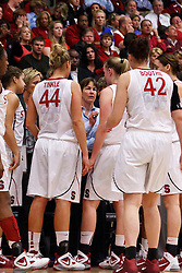 March 21, 2011; Stanford, CA, USA; Stanford Cardinal head coach Tara VanDerveer (center, back) huddles with her team during a time out against the St. John's Red Storm during the second half of the second round of the 2011 NCAA women's basketball tournament at Maples Pavilion. Stanford defeated St. John's 75-49.