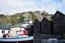Historic fishing huts with East Hill Cliff railway in the background, Hastings, East Sussex UK Oct 2016