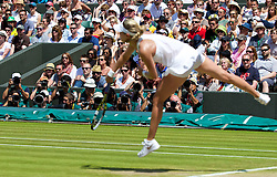 02.07.2014, All England Lawn Tennis Club, London, ENG, WTA Tour, Wimbledon, im Bild Photographers and spectators look on as Eugenie Bouchard (CAN) serves during the Ladies' Singles Quarter-Final match on day nine // during the Wimbledon Championships at the All England Lawn Tennis Club in London, Great Britain on 2014/07/02. EXPA Pictures © 2014, PhotoCredit: EXPA/ Propagandaphoto/ David Rawcliffe<br /> <br /> *****ATTENTION - OUT of ENG, GBR*****