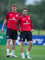 CARDIFF, WALES - Monday, August 13, 2012: Wales' Joe Allen and Simon Church during a training session at the Vale of Glamorgan ahead of the international friendly match against Bosnia-Herzegovina. (Pic by David Rawcliffe/Propaganda)