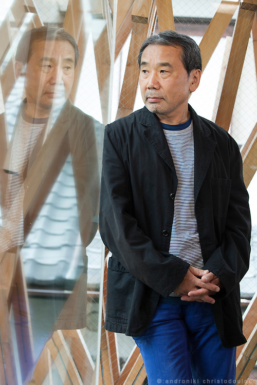 Japanese author Haruki Murakami inside the building of Sunny Hills, a confectionery shop in Aoyama which was designed by the Japanese architect Kuma Kengo. Tokyo, Japan