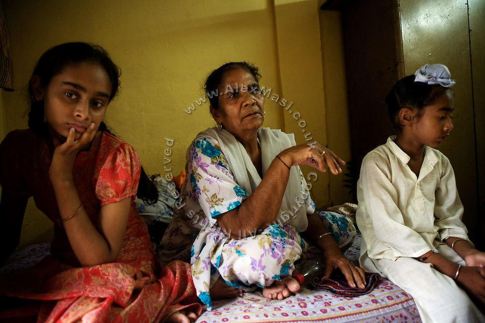 Surinder Kaur, 65, (centre) is portrayed in another widow's home in Tilak Vihar, New Delhi, India. She has lost her husband and other members of her family during the anti-Sikh riots erupted in New Delhi in 1984 in the light of Indira Gandhi's assassination by her Sikh bodyguards.