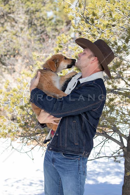 cowboy loving his puppy