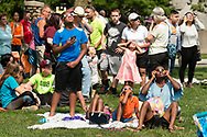 Middletown, New York - People gather on Alumni Green at SUNY Orange to watch a partial solar eclipse on Aug. 21, 2017. The family in front is using eclipse glasses.