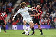 Manchester United Midfielder Marouane Fellaini battles with Andrew Surman (6) of AFC Bournemouth  during the Premier League match between Bournemouth and Manchester United at the Vitality Stadium, Bournemouth, England on 18 April 2018. Picture by Phil Duncan.