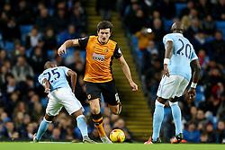 Harry Maguire of Hull City is fouled by Fernandinho of Manchester City  - Mandatory byline: Matt McNulty/JMP - 01/12/2015 - Football - Etihad Stadium - Manchester, England - Manchester City v Hull City - Capital One Cup - Quarter-final