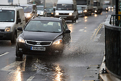 © Licensed to London News Pictures. 15/09/2015. Brighton, UK. A car driving through built up surface water as high winds and heavy rain batter Brighton seafront on  the south coast of England.  Photo credit: Ben Cawthra/LNP