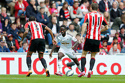 Nathan Dyer of Swansea City is challenged by Patrick van Aanholt and Adam Johnson of Sunderland - Photo mandatory by-line: Rogan Thomson/JMP - 07966 386802 - 27/08/2014 - SPORT - FOOTBALL - Sunderland, England - Stadium of Light - Sunderland v Swansea City - Barclays Premier League.