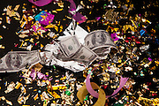 Confetti and play money litter the ground. The play money is to usher in good furtune.