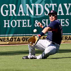 March 11, 2011; Fort Myers, FL, USA; Boston Red Sox left fielder Juan Carlos Linares makes a catch during a spring training exhibition game against the Minnesota Twins at Hammond Stadium.  Mandatory Credit: Derick E. Hingle-US PRESSWIRE