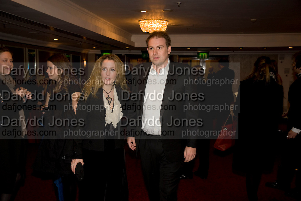 Gillian Anderson; Mark Griffiths, The Laurence Olivier Awards, The Grosvenor House Hotel. Park Lane. London. 8 March 2009 *** Local Caption *** -DO NOT ARCHIVE -Copyright Photograph by Dafydd Jones. 248 Clapham Rd. London SW9 0PZ. Tel 0207 820 0771. www.dafjones.com<br /> Gillian Anderson; Mark Griffiths, The Laurence Olivier Awards, The Grosvenor House Hotel. Park Lane. London. 8 March 2009