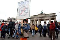 """15 FEB 2003, BERLIN/GERMANY:<br /> Grossdemonstration """"Nein zum Krieg gegen den Irak"""", Demonstranten mit Transparenten maschieren durch das Brandenburger Tor<br /> Demonstration """"No war on Iraq"""", demonstrators with banners are walking trough the Brandenburger Tor<br /> IMAGE: 20030215-01-010<br /> KEYWORDS: Demonstration, Demonstrant, Protest, Schild, sign, banner, anti-war, Kleine Maedchen, Mädchen, girl"""