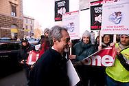 Roma 20 Dicembre 2011.Celebrazione del centenario del primo contratto giornalistico organizzato dall'Fnsi. .Il sottosegretario alla presidenza del Consiglio per l'editoria, Carlo Malinconico  e i giornalisti di Liberazione che protestano per la chiusura del giornale