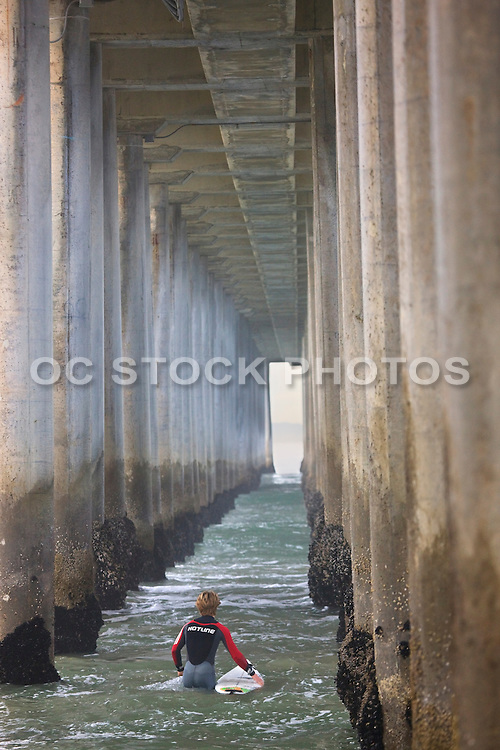 Surfers Under The Huntington Beach Pier Orange County, California
