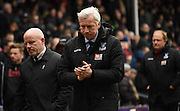 A glum Alan Pardew applaudes the home support after the Barclays Premier League match between Crystal Palace and Liverpool at Selhurst Park, London, England on 6 March 2016. Photo by Michael Hulf.
