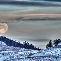 The moon sets in the Slough Creek area of Yellowstone National Park.
