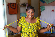 Anna Nyamanda in her tailoring shop.<br /> <br /> Anna set up and now runs a tailoring business selling a variety of home furnishings in Mwanalugali, Tanzania.<br /> <br /> She attended MKUBWA enterprise training run by the Tanzania Gatsby Trust in partnership with The Cherie Blair Foundation for Women.