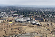 Aug 18, 2019; Inglewood, CA, USA: General overall aerial view of L.A. Stadium and Entertainment District at Hollywood Park under construction with the Forum in the background. The venue, privately financed by Los Angeles Rams owner Stan Kroenke, is scheduled to open in 2020. It will be the home to the Rams and the Los Angeles Chargers and will play host to Super Bowl LVI in 2022, 2023 College Football National Championship and the opening and closing ceremonies of the 2028 Olympics.