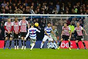 QPR midfielder Luke Freeman (7) takes a free kick in front of goal during the EFL Sky Bet Championship match between Queens Park Rangers and Brentford at the Loftus Road Stadium, London, England on 10 November 2018.