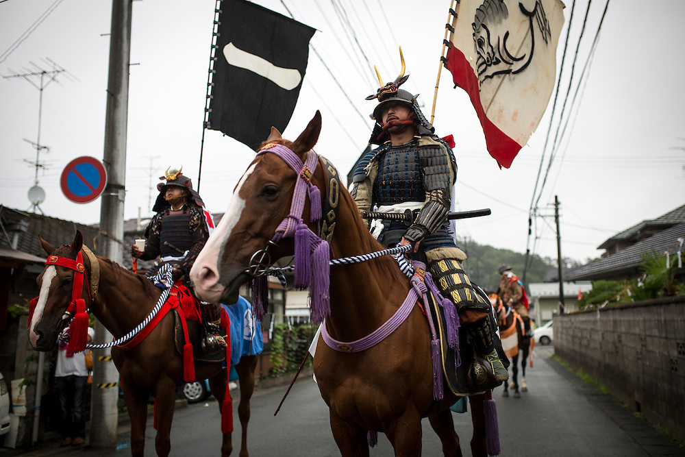 """MINAMISOMA, JAPAN - JULY 24 :  A samurai horsemen prepares to leave for """"Hon Matsuri"""" parade after a ritual during the Soma Nomaoi festival at Minamisoma city on Sunday, July 24, 2016 in Fukushima Prefecture, Japan. """"Soma-Nomaoi"""" is a three day traditional festival that recreates a samurai battle scene from more than 1,000 years ago. The festival has gathered more than thousands visitors as Fukushima still continues to recovery from the 2011 nuclear disaster, the samurai warriors battles for recovery of the area. (Photo: Richard Atrero de Guzman/NURPhoto)"""