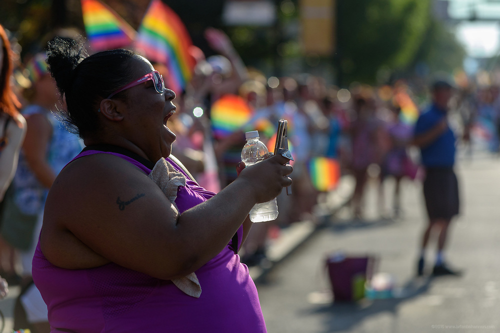 Jamie Swope streams the parade to Facebook.<br /> The Lesbian, Gay, Bisexual, Transgender, and Queer (LGBTQ) community and their friends, family and supporters walked and lined Main Street from Floyd Street to the Belvedere for the Kentuckiana Pride Parade, Saturday, June 16, 2017 in Louisville, Ky. (Photo by Brian Bohannon)