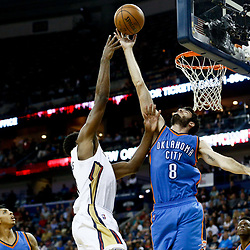 Jan 25, 2017; New Orleans, LA, USA; Oklahoma City Thunder guard Alex Abrines (8) blocks a shot by New Orleans Pelicans guard Tyreke Evans (1) during the second half of a game at the Smoothie King Center. The Thunder defeated the Pelicans 114-105. Mandatory Credit: Derick E. Hingle-USA TODAY Sports