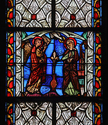 Annunciation, with the Archangel Gabriel visiting Mary, stained glass window, late 13th century, from a series of windows on the New Testament, in the Chapelle Saint Joseph, the North apse chapel of the Basilique Saint-Urbain de Troyes, or Basilica of Saint Urban of Troyes, a 13th century Gothic church in Troyes, Aube, France. The basilica was founded in 1262 under Pope Urban IV and consecrated in 1382, although the building was not completed until the 20th century. It is listed as a national monument. Picture by Manuel Cohen