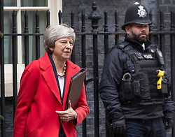 © Licensed to London News Pictures. 04/12/2018. London, UK. London, UK. Prime Minister Theresa May emerges from number 10 Downing Street as she leaves for Parliament. Today the House of Commons will start the first of five days of debate on the Brexit withdrawal agreement.  Photo credit: Peter Macdiarmid/LNP