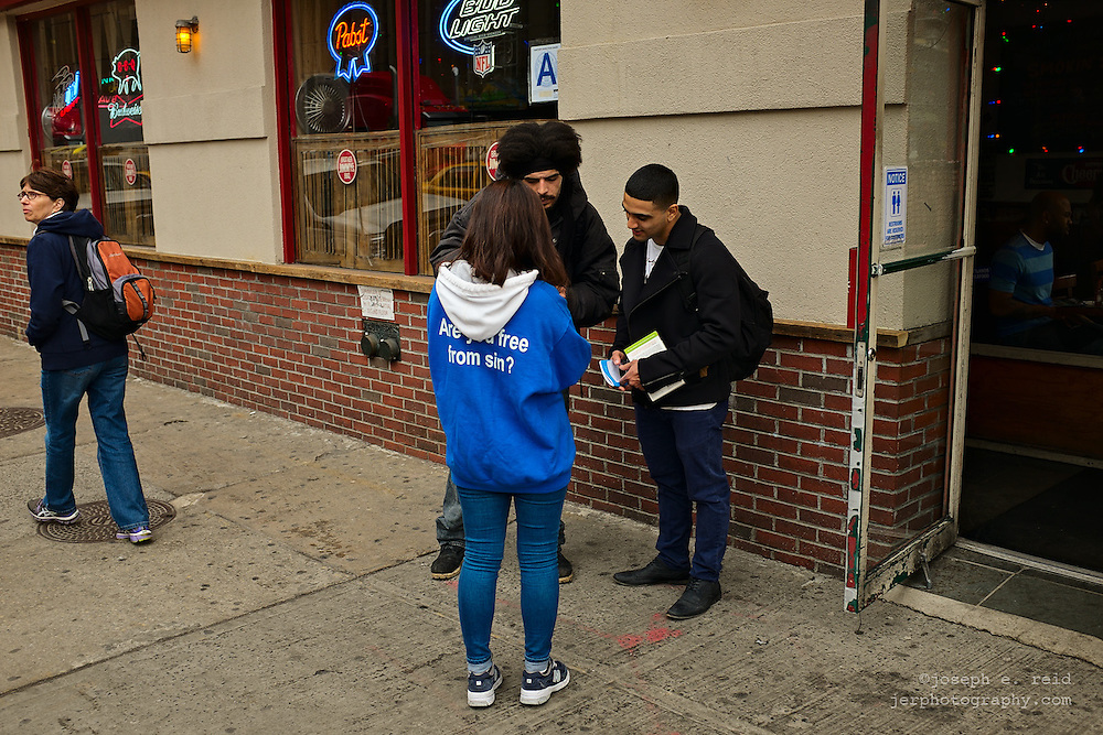 Woman handing out religious information, New York, NY, US
