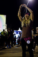 A concert-goer visits the stretch of booths at the San Diego Street Scene Music Festival in San Diego, California on September 19, 2008.