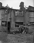 29/09/1960<br /> 09/29/1960<br /> 29 September 1960<br /> Sheridan family house fire at Walkinstown, Dublin. The house at 18 Hardebeck Avenue after the fire.
