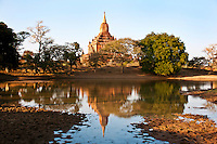 Shwegugyi Temple seen from the water, Old Bagan, Myanmar. Exotic places photography prints for sale.
