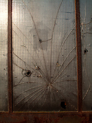 CZECH REPUBLIC NEDVEZI APR09 - Broken glass at the entrance door of a joiner's workshop, Hartmanice, Vysocina, Czech Republic...jre/Photo by Jiri Rezac..© Jiri Rezac 2009
