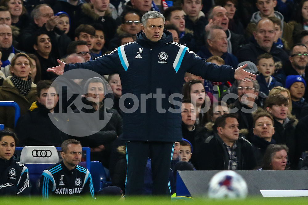 Jose Mourinho, Manager of Chelsea, holds his arms out during the Capital One Cup Semi Final 2nd Leg match between Chelsea and Liverpool at Stamford Bridge, London, England on 27 January 2015. Photo by David Horn.