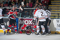 KELOWNA, CANADA - NOVEMBER 21: Colten Martin #8 of Kelowna Rockets checks a player of the Portland Winterhawks into the boards after a hit on Jesse Lees #2 of Kelowna Rockets on November 21, 2014 at Prospera Place in Kelowna, British Columbia, Canada.  (Photo by Marissa Baecker/Shoot the Breeze)  *** Local Caption *** Jesse Lees; Tomas Soustal; Colten Martin; Joe Gatenby;