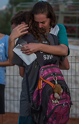 Israeli young women embrace each other at a joint funeral for the three Israeli teens at a cemetery in Modi'in near Jerusalem, on July 1, 2014. The three Israeli teens whose bodies were found Monday evening were brought to rest side by side on Tuesday at a joint funeral held in Modi'in near Jerusalem. Tens of thousands of people participated in the funeral, including Prime Minister Benjamin Netanyahu and President Shimon Peres, who eulogized the three, whose caskets were wrapped with Israeli flags. EXPA Pictures © 2014, PhotoCredit: EXPA/ Photoshot/ Li Rui<br /> <br /> *****ATTENTION - for AUT, SLO, CRO, SRB, BIH, MAZ only*****